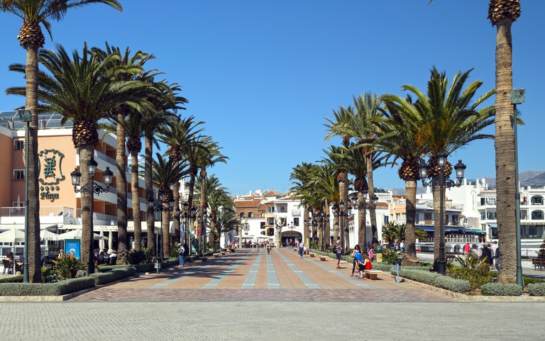The avenue of palm trees along the Balcon de Europa, Nerja, Andalusia, Spain.