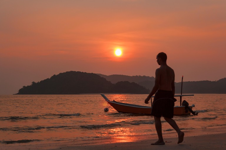 Sunset over chenang beach in langkawi island malaysia.