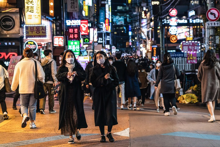 Seoul, South Korea. 6th Nov, 2020. People wearing protective masks as a precaution walk the street at Gangnam station where nightlife is high on a Friday night. Credit: Simon Shin/SOPA Images/ZUMA Wire/Alamy Live News