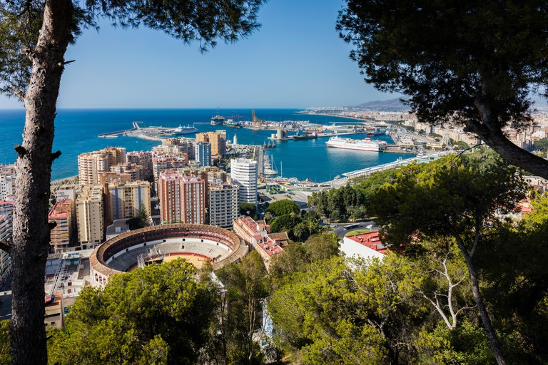 Malaga, Costa del Sol, Malaga Province, Andalusia, southern Spain.  Overall view of bullring and port from National Parador