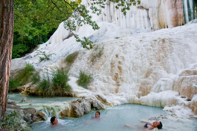 Fosso Bianco near San Filippo, white calcified waterfall in the woods with turquoise thermal water