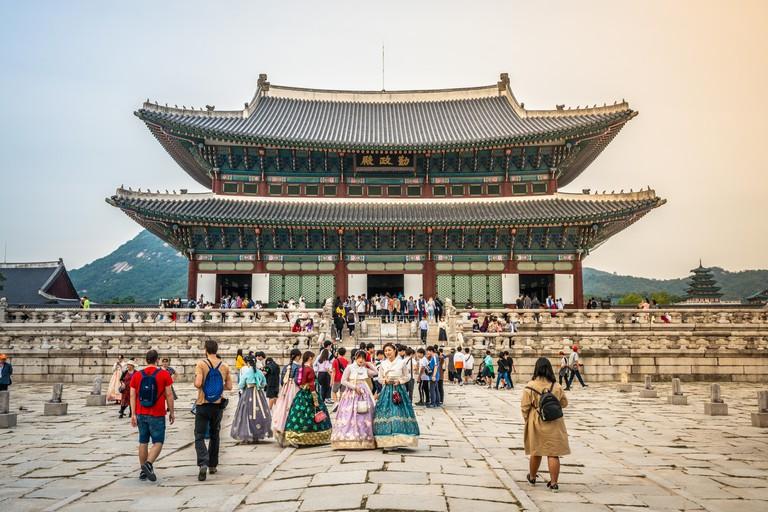 Seoul Korea , 25 September 2019 : Gyeongbokgung palace main throne hall aka Geunjeongjeon view with tourists in Hanbok traditional dressing in Seoul S