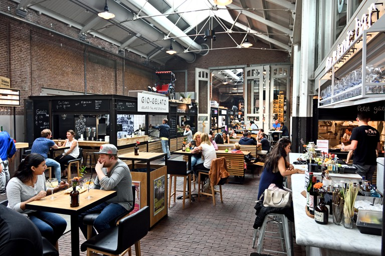 """FOOD HALLS - FOODHALLEN AMSTERDAM West near Kinkerstraat  The very first """"indoor food market in the Netherlands, where you can enjoy good food and drink on site. ( former tram remise now a center for media fashion crafts arts )  Dutch Netherlands"""