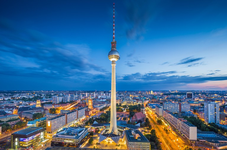 Berlin skyline with famous TV tower at Alexanderplatz in twilight at dusk, Germany