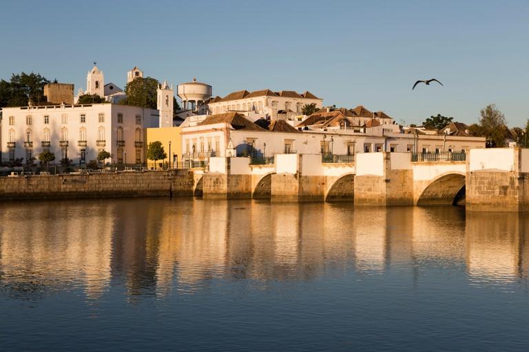Seven arched Roman bridge and town on the Rio Gilao river, Tavira, Algarve, Portugal, Europe