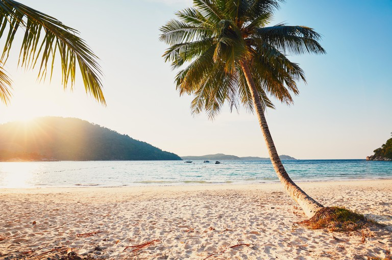 Sunset in paradise. Idyllic beach on the Perhentian islands in Malaysia.