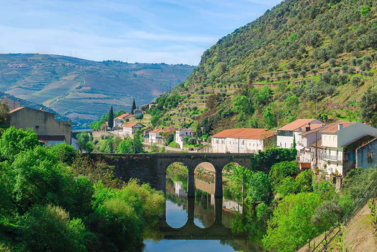 Douro Valley Portugal, the town of Pinhao in the Douro region showing the   old roman bridge that spans the Pinhao River, Portugal.