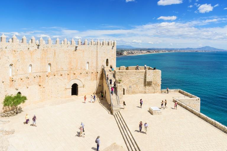Tourists exploring Papa Luna's Castle, Peniscola, Spain