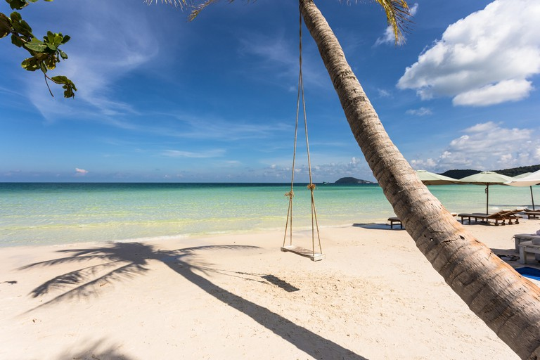 Swing attached to a palm tree in the idyllic Bai Sao beach in Phu Quoc island in Vietnam in the Gulf of Thailand.