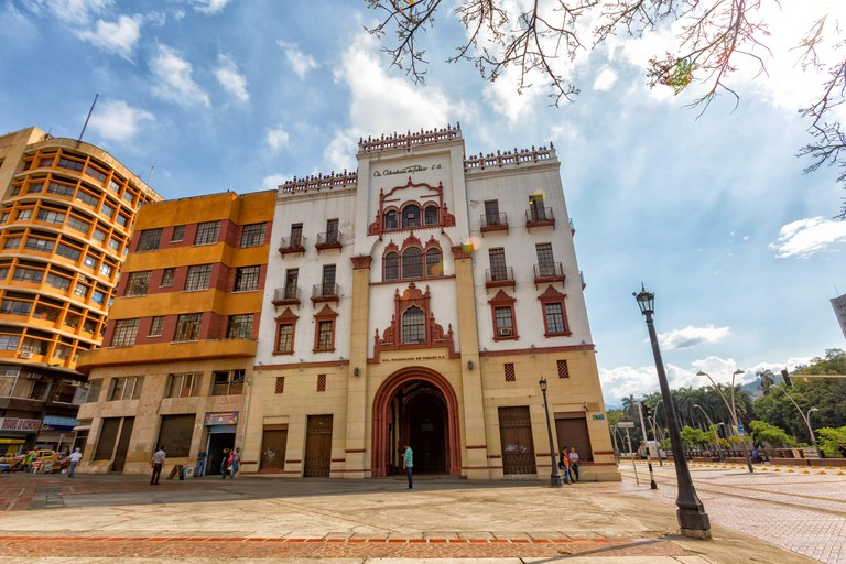 CALI, COLOMBIA - JUNE 11: Unidentified people walk past the facade of the Edificio Coltobaco in downtown Cali, Colombia on June 11, 2016.