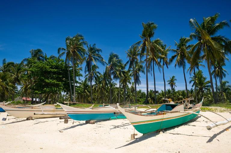 Fishing boats on beach, Guimbatayan, Cebu Island, Philippines