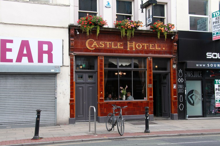 The Castle Hotel with a tiled facade in the Northern Quarter of Manchester