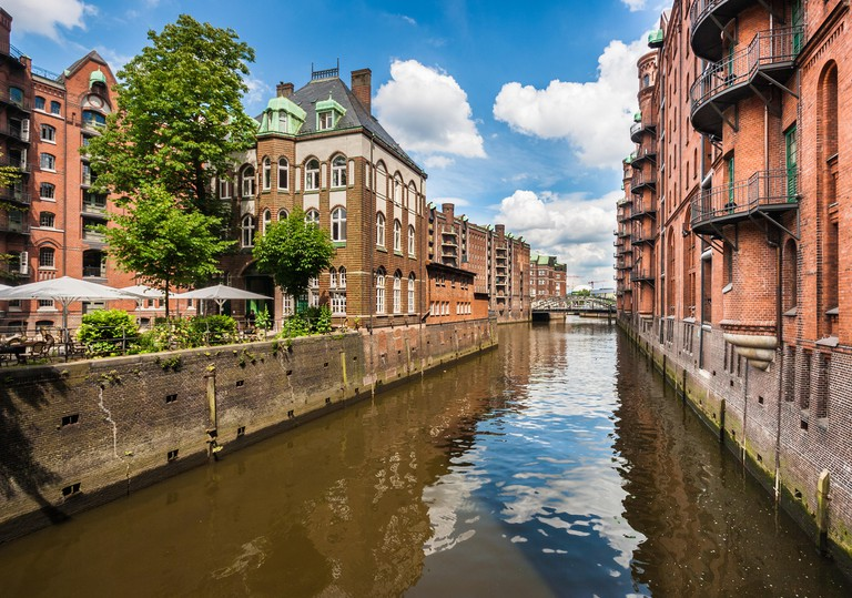 Famous Speicherstadt warehouse district with blue sky and clouds in Hamburg, Germany