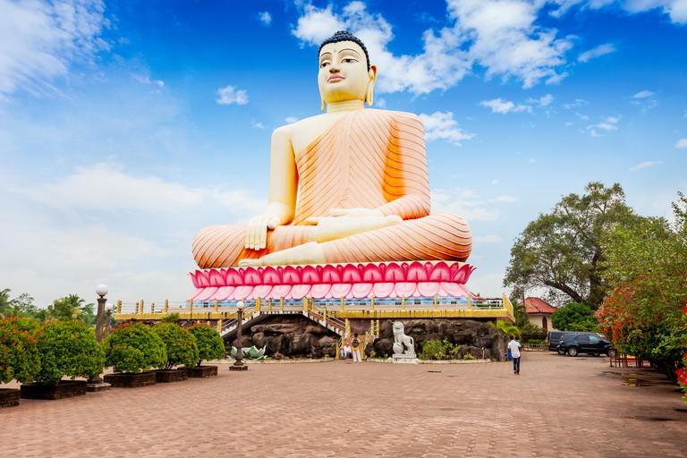 Big Buddha statue at the Kande Vihara Temple. Kande Viharaya is a major Buddhist temple near Bentota beach in Sri Lanka