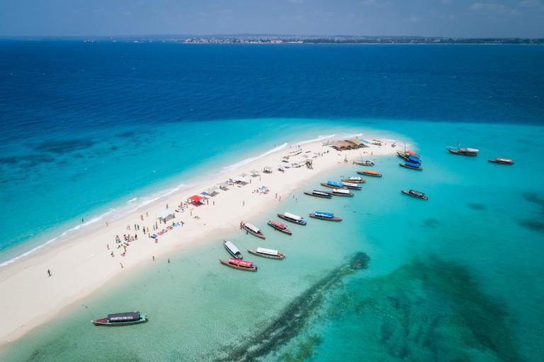 Aerial view of beautiful sand tropical island Nakupenda with white sand beach and tourists, Zanzibar
