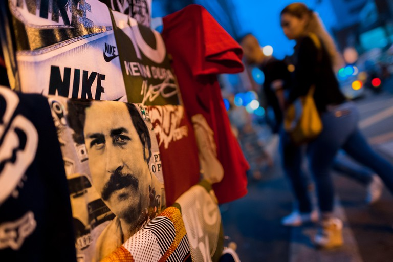 A t-shirt for sale, depicting the drug lord Pablo Escobar, is seen arranged at the market stand on the street in Medellin, Colombia.