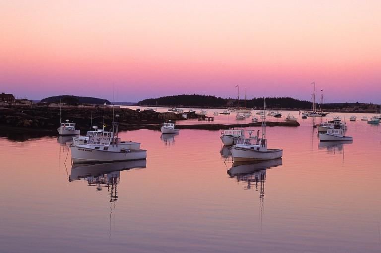The afterglow (following sunset) on Stonington Harbor, Maine, USA
