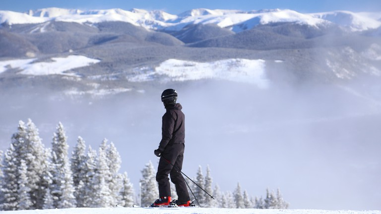 Skier alone at Breckenridge ski resort in the Colorado Rocky Mountains