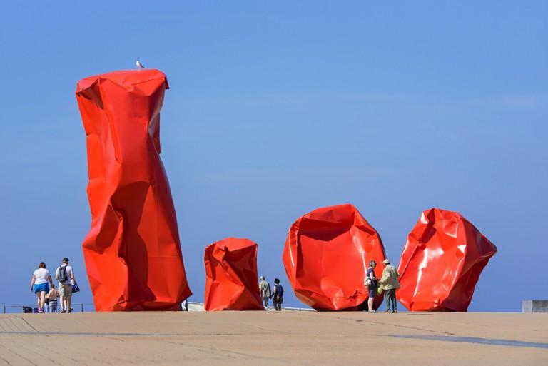 Conceptual work of art Rock Strangers by artist Arne Quinze at seaside resort Ostend / Oostende, West Flanders, Belgium
