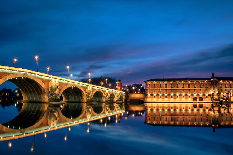 The Pont Neuf Bridge in Toulouse, France in the early evening