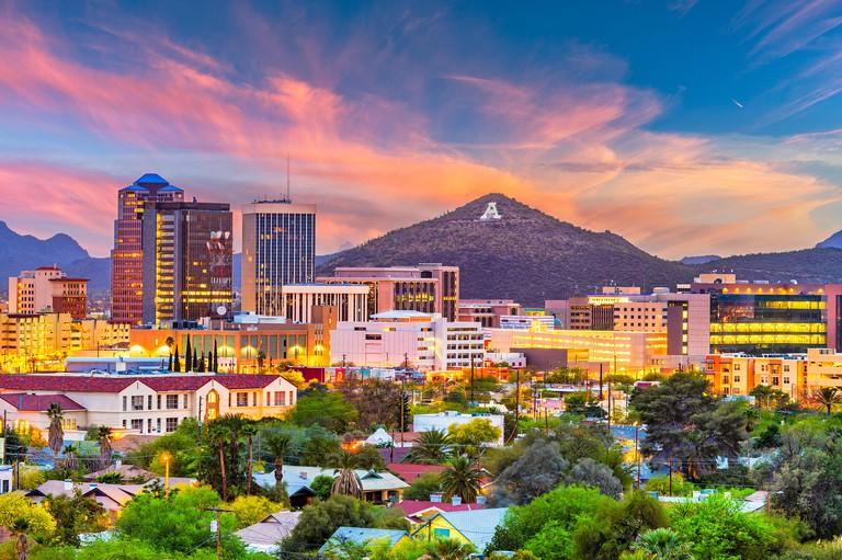 Tucson, Arizona, USA downtown skyline with Sentinel Peak at dusk. (Mountaintop A  for Arizona)