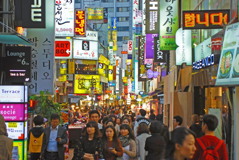 Shoppers and nightlife among the streets of Myeongdong, Seoul, South Korea