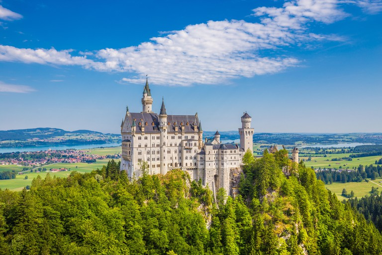 Classic view of world-famous Neuschwanstein Castle, one of Europe's most visited castles, in summer, Bavaria, Germany -- H34MB6