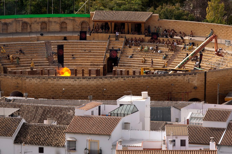 """Extras take part in the filming of the fifth season of the HBO TV series """"Game of Thrones'"""" inside a bullring in downtown Osuna, near Seville, southern Spain October 26, 2014. The Home Box Office Inc. is filming part of the fifth season of the American fa"""
