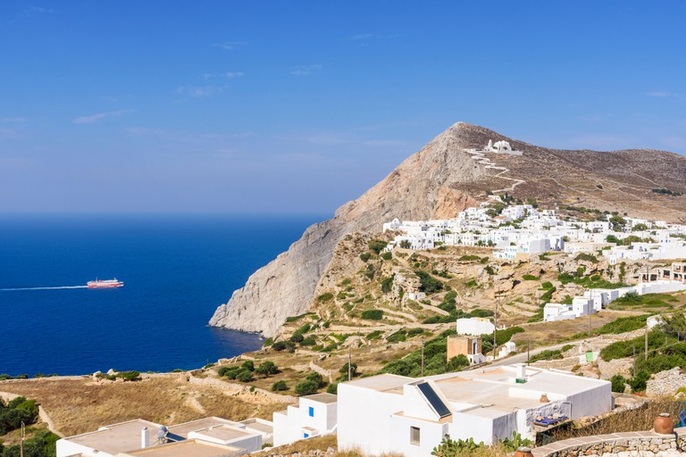 Folegandros Island views of the cliff top whitewashed buildings in the Chora, Folegandros, Cyclades, Greece
