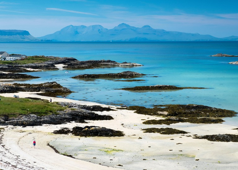 A sandy beach at Traigh near Arisaig with the islands of Eigg and Rum in the distance. - P7823E