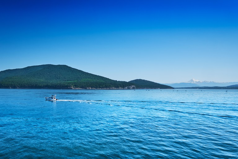 Summer weekend boaters enjoy calm seas and scenic views of Mt Baker in the San Juan Islands, Washington