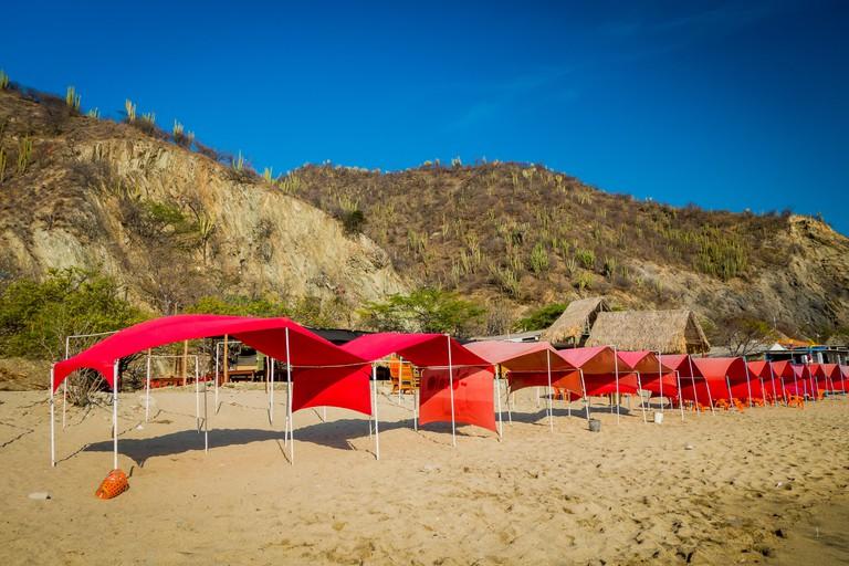 Tents in Playa Blanca beach, Santa Marta, Colombia