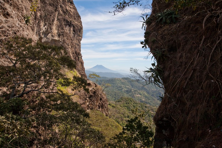 The Puerta del Diablo consists of two enormous, nearly vertical rocks which frame a magnificent view of the Volcan San Vicente.
