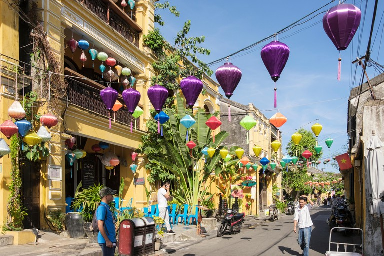 Colourful lanterns hanging above a narrow street in the old town. Hoi An, Quang Nam Province, Vietnam, Asia