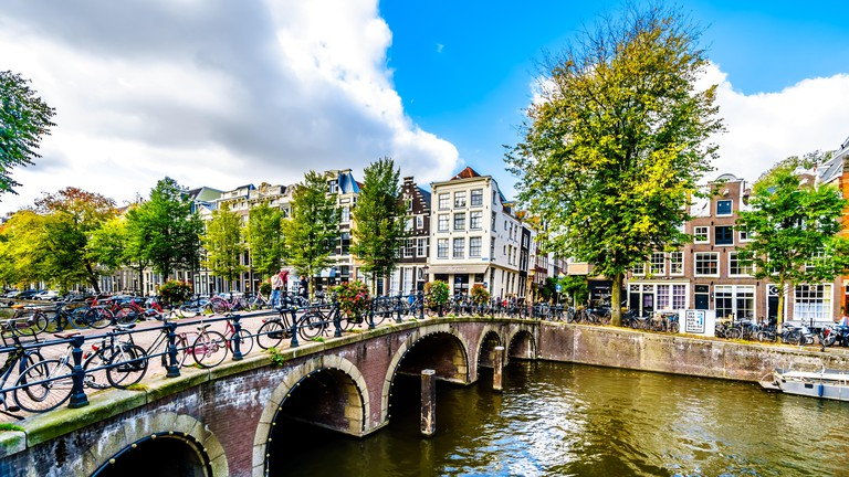 The bridge over Blauwburgwal canal at the junction with the Herengracht canal in the city center of Amsterdam, the Netherlands