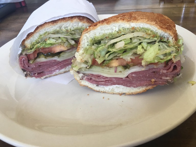 Fresh pastrami sandwich on a Dutch crunch roll