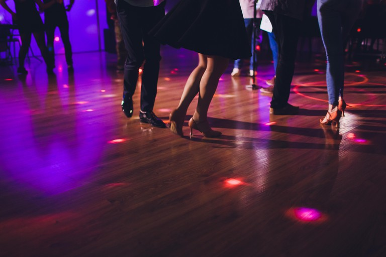 Legs of dancing people at the party