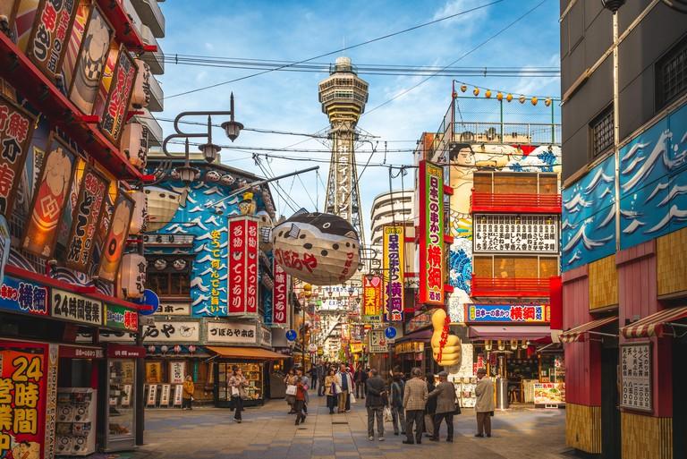 WB02K3 Osaka, Japan - November 21, 2018: street view of Shinsekai and Tsutenkaku tower in osaka. shinsekai is a retro downtown area of southern Osaka