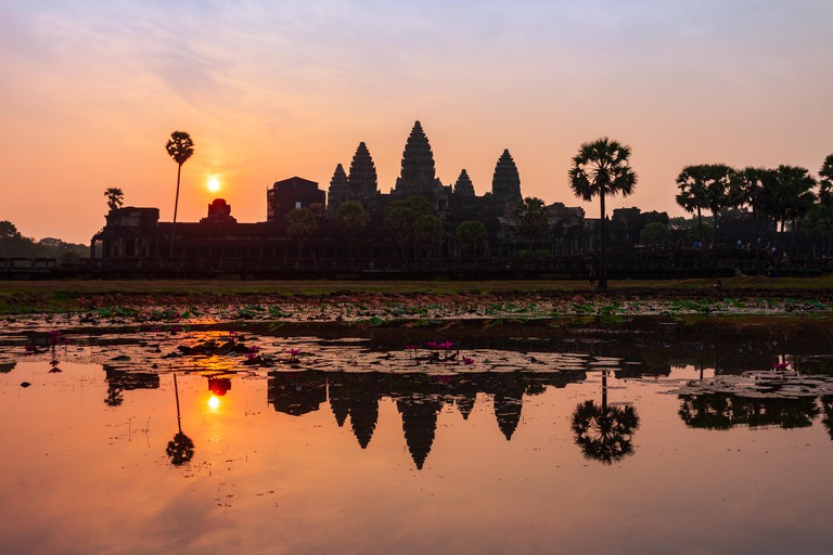Angkor Wat temple in Siem Reap in Cambodia at sunrise. Angkor Wat is the largest religious monument in the world.
