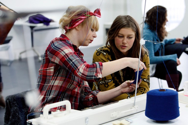 Students studying for a BA Hons in Fashion Textiles in a knitting workshop. Ravensbourne specialist higher education college, London. 06.12.2010.
