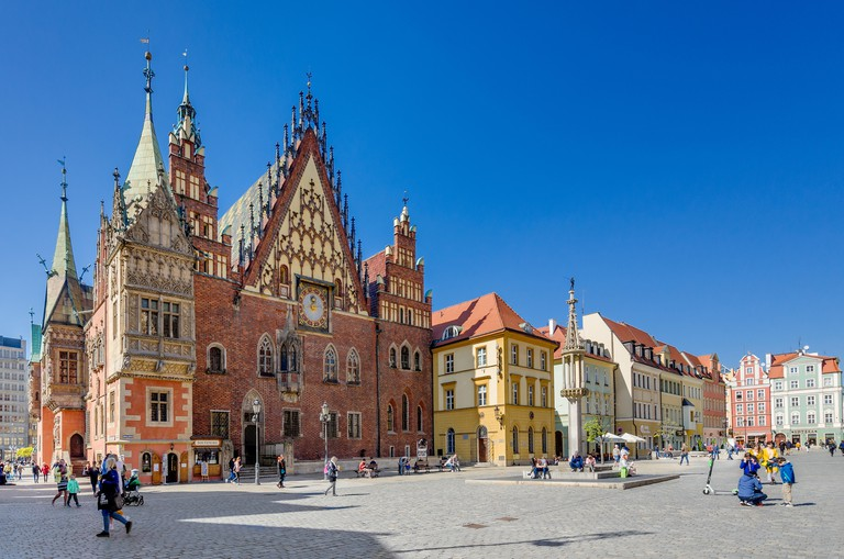Wroclaw, Lower Silesian province, Poland. Old city hall with pillory opposite. Market Square, Old Town district.