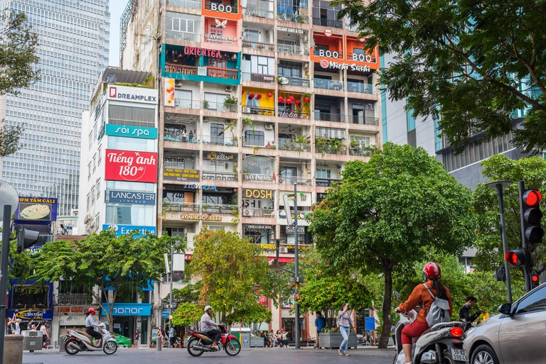 Ho Chi Minh City, Vietnam - April 7, 2019: The Cafe Apartment, an old residential house turned into a hub of cafes in Nguyen Hue Street, the downtown.