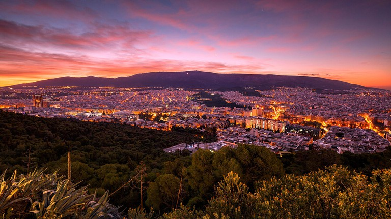 View of eastern Athens and Hymettus mountain from Lycabettus hill at dawn..