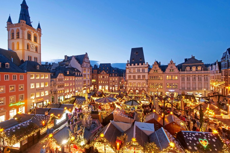 Christmas market on the main market with St. Gangolf church, Trier, Mosel, Rhineland-Palatinate, Germany