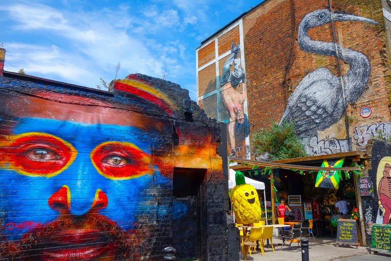 TRT279 Colourful Graffiti on walls - Brick Lane, East London.