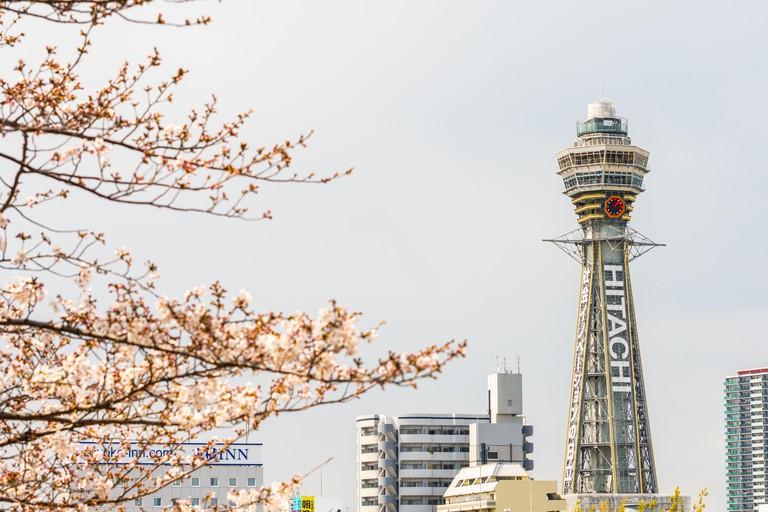 Osaka, JAPAN - CIRCA April, 2019:Tsutenkaku Tower is a tower and well-known landmark of Osaka, Japan and advertises H2C8MR2T Osaka, JAPAN - CIRCA April, 2019:Tsutenkaku Tower is a tower and well-known landmark of Osaka, Japan and advertises Hitachi, located in the Shinseka