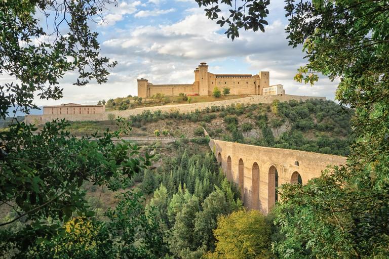 Ponte delle torri medieval bridge and Rocca Albornoziana hilltop fortress in Spoleto, Province of Perugia, Italy