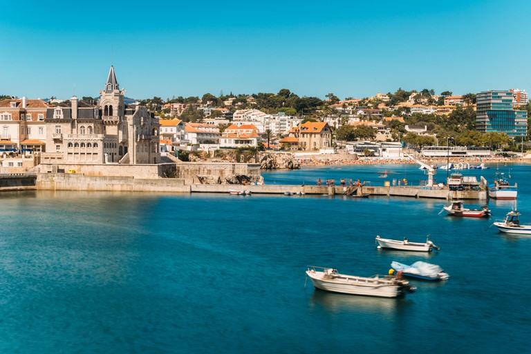 Beach, town and dock of Cascais at summer, Portugal.