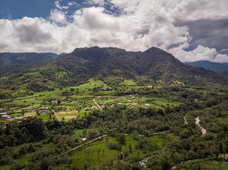 Panoramic view from Mindo Valley, Ecuador. Many rivers, big mountains, little towns and green vegetation can be appreciated.
