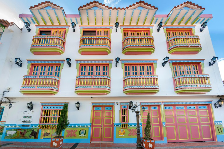 Building facade in the town of Guatape, Colombia.